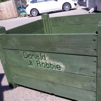 A planter made for Donald and Robbie, it allows a wheel chair user to maintain flowers at his door.